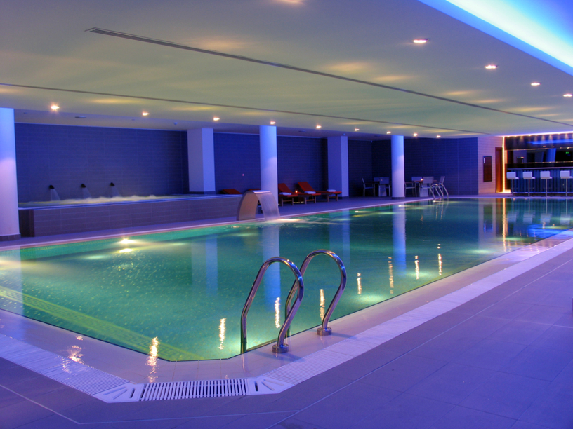 Ultra modern indoor pool with nightclub style lighting