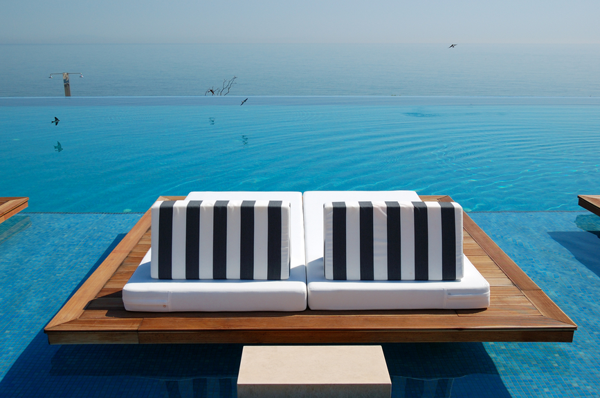 Lounge seats in infinity pool