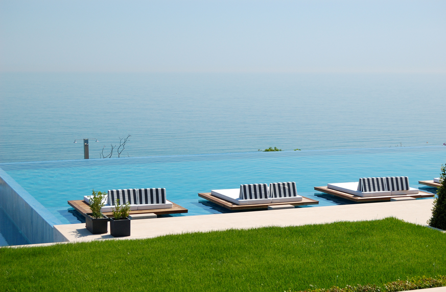 Infinity pool with comfortable patio chairs