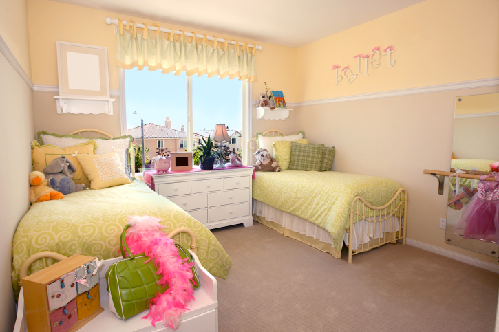 bedroom for two children with matching beds and white dresser drawers - Kids Bedroom