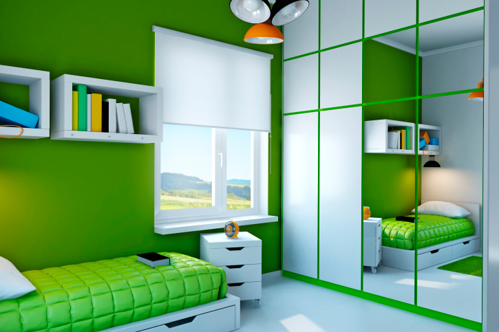 vibrant playful green and white childs bedroom with built in closet and white floor