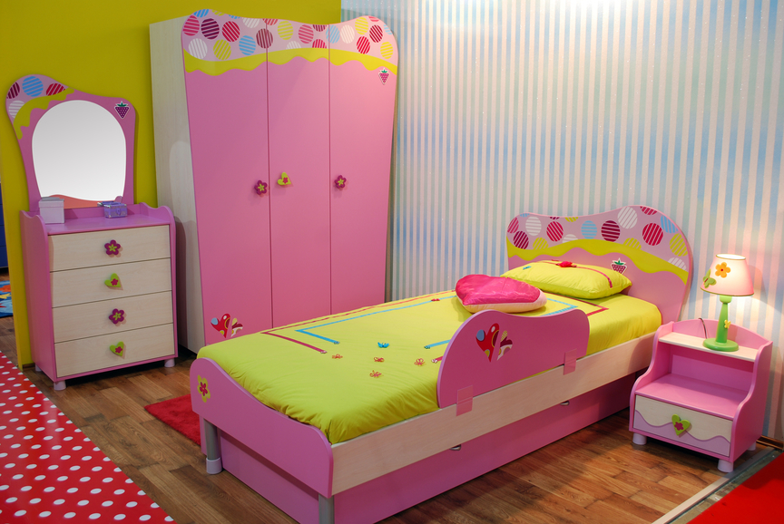 playful girls bedroom with pink and green color scheme and fun furniture