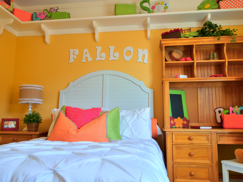 playful room with bright yellow wall and desk - Kids Bedroom