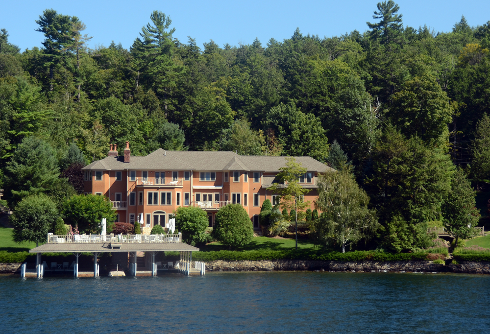 Huge red brick mansion on the lake in remote forested area