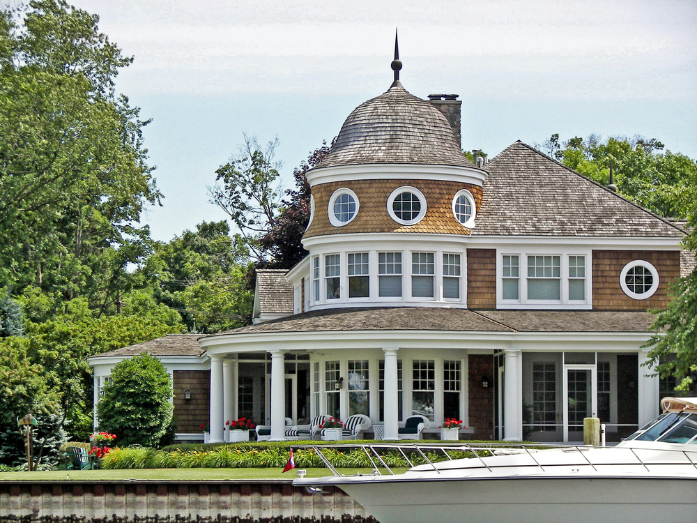 Contemporary Victorian home with wrap-around porch on a canal