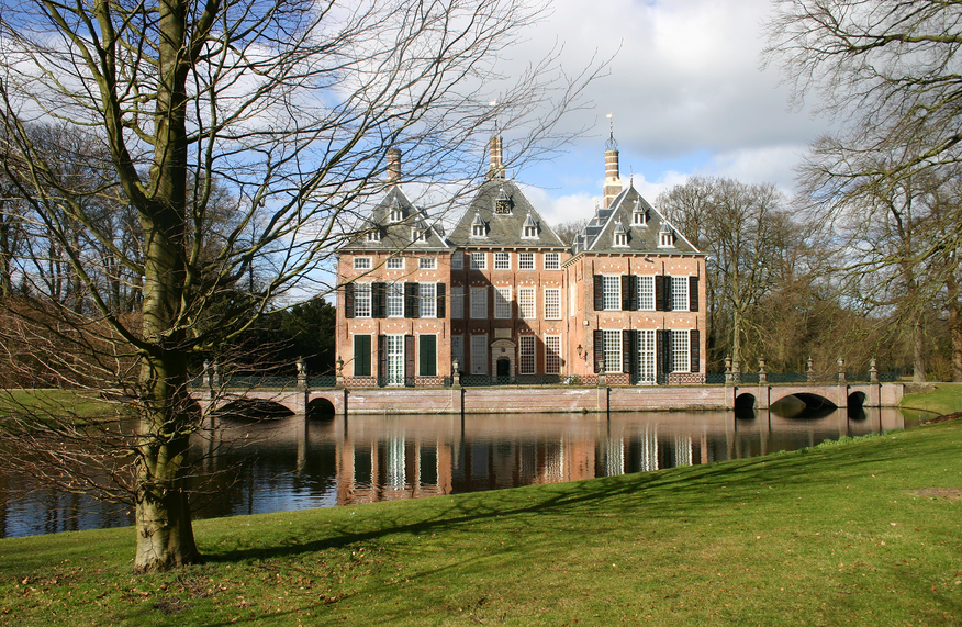 Red brick Castle Duivenvoorde on the lake in Voorschoten, Netherlands