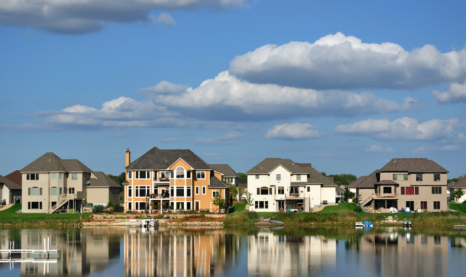 Row of large contemporary homes on suburban lake