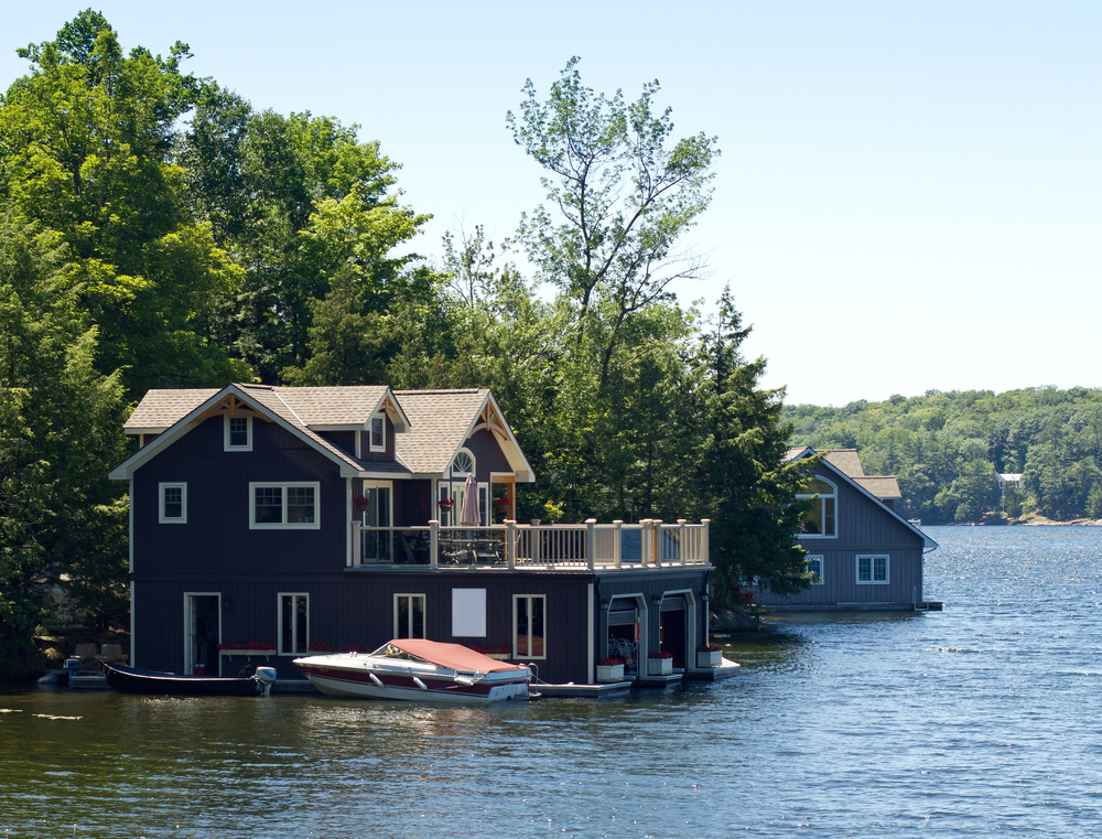 Classic lake home with sun deck over on top of boat garage