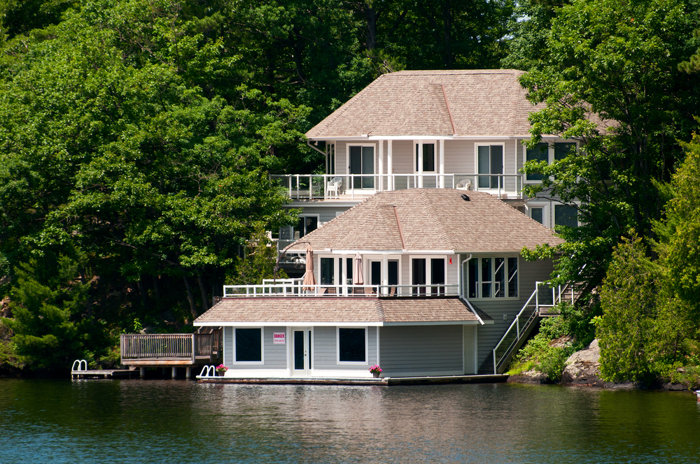 Lake home with boat garage and large sun deck on the water