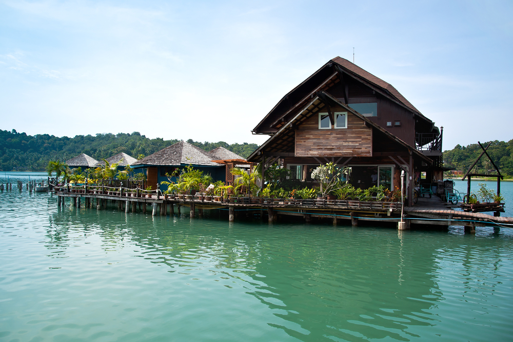 Wood home built on wooden dock on the water
