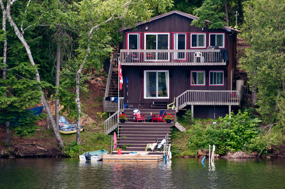 Small wood cabin in the forest with steps down to private dock on the lake
