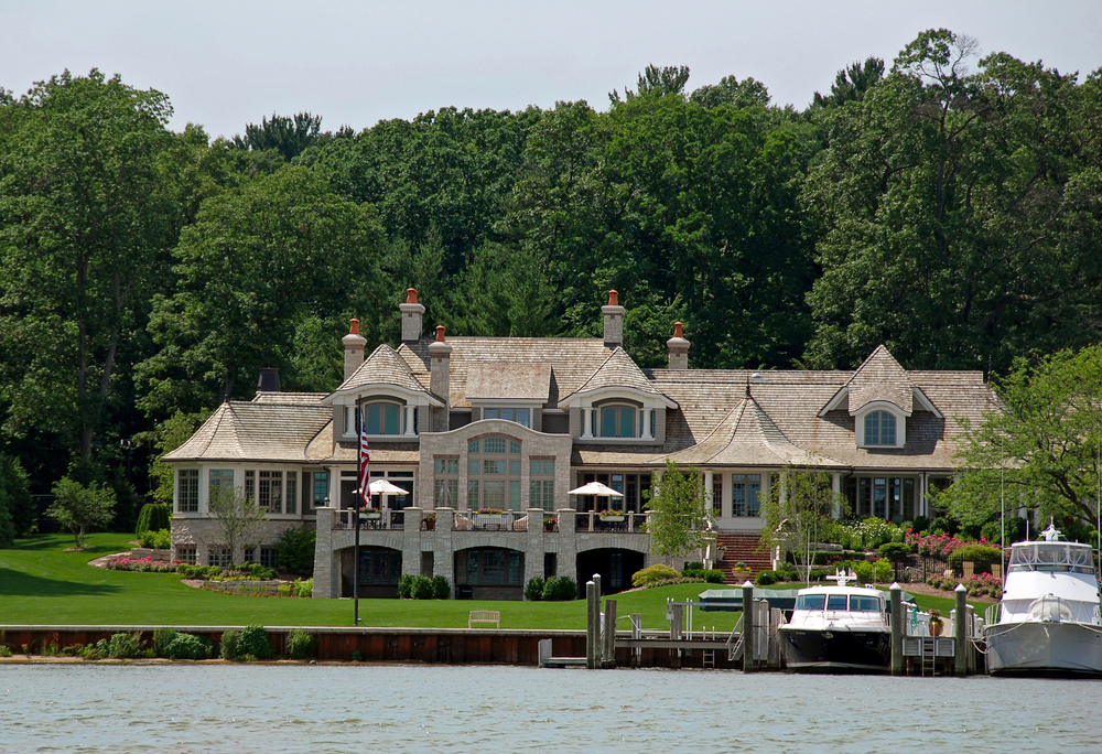 Contemporary mansion on large lot on the lake with private dock for yachts