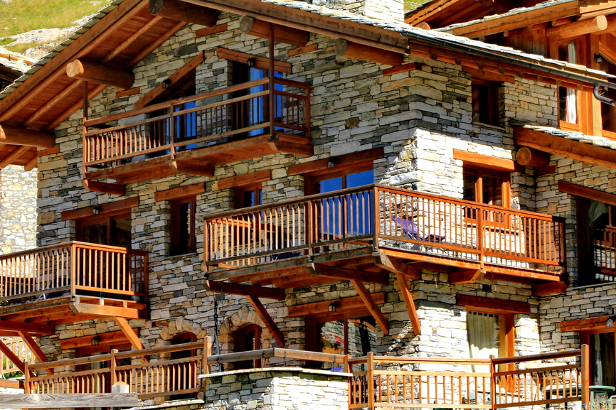 Large stone and wood beamed ski chalet.