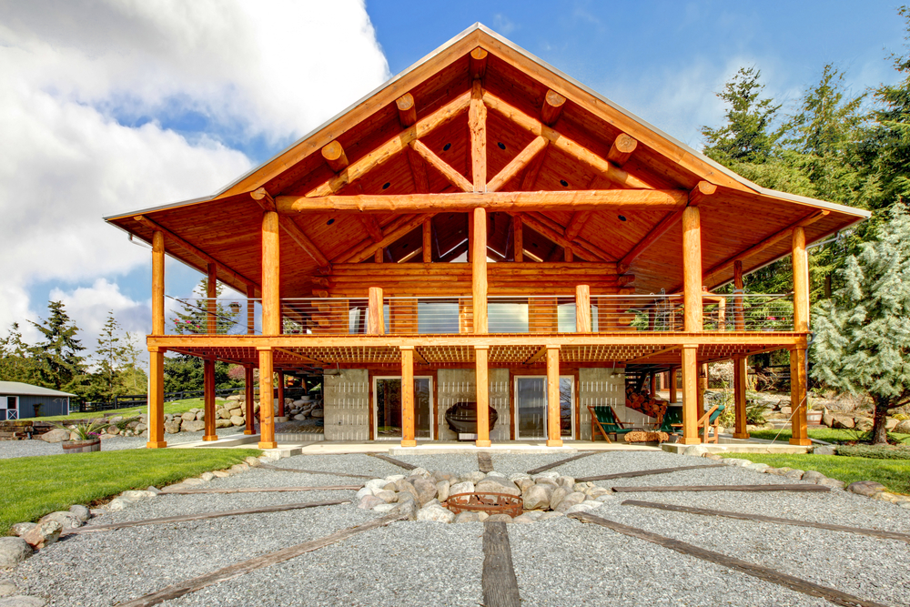 Southern Style Log Home With Large Second Story Wrap Around Veranda.