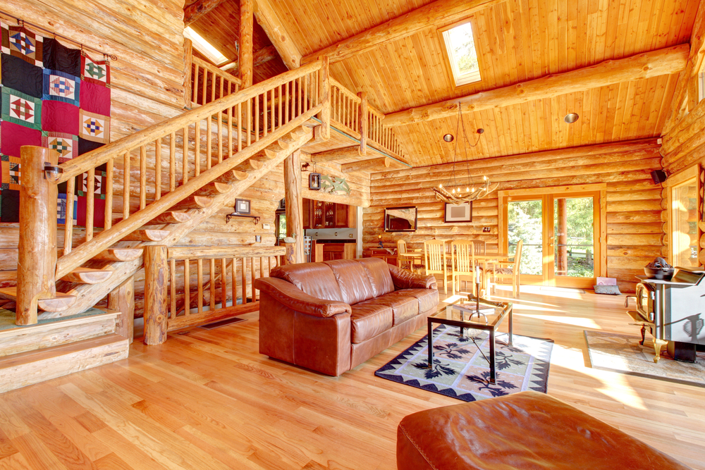 The Great Room Interior Of A Log Home With Stairs Going To A Loft.