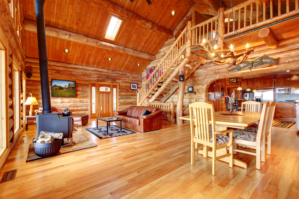 ... open concept living room and dining room and loft of a large log home