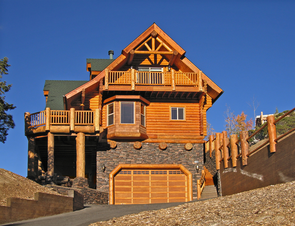 Large ski resort log home chalet built with log and stone