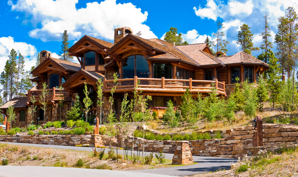 Ski resort log home mansion among trees