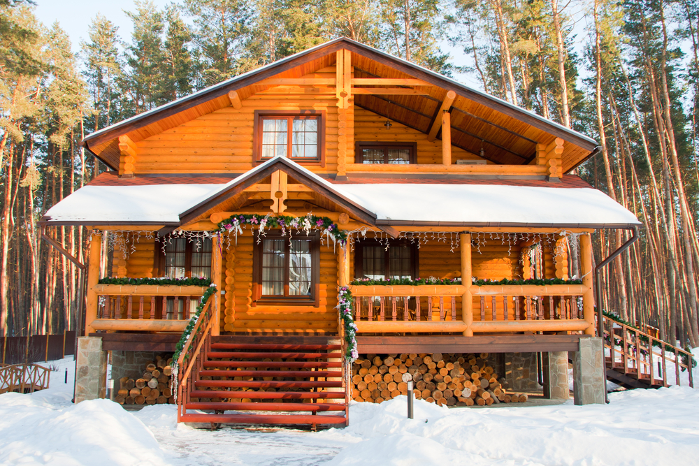Log home ski chalet with front porch and second story deck