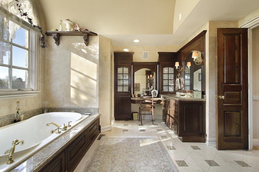 Spacious Bathroom In Earth Tones And Dark Brown Plenty Of Wood Work
