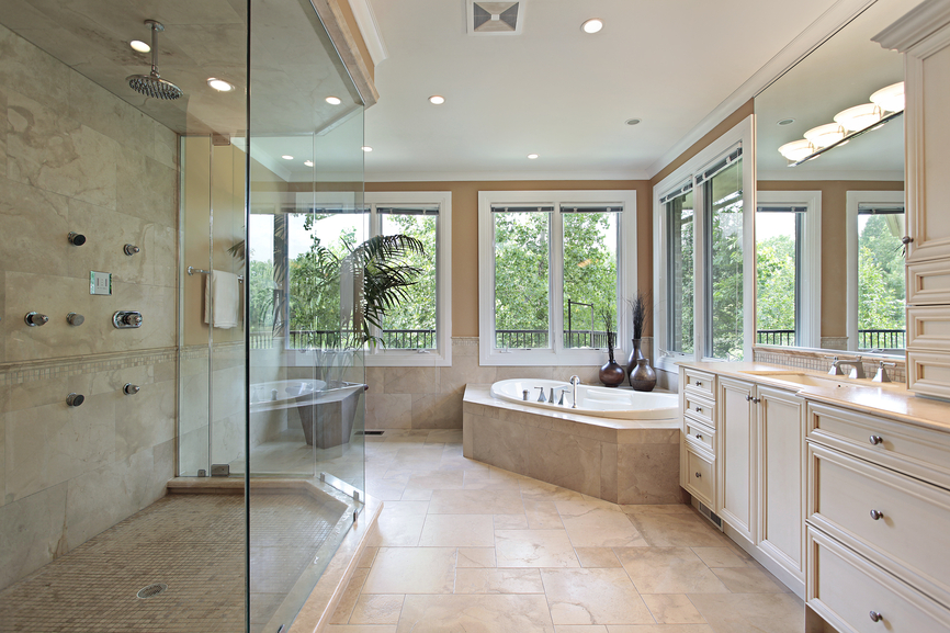 Several Large Windows Surrounding Tub Provide This Large Bathroom With