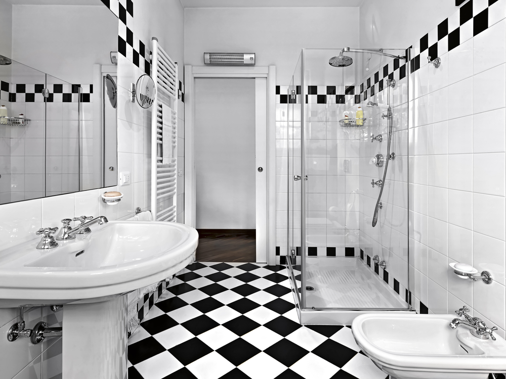 Black And White Bathroom With Extensive White Tiling Offset With Black And  White Checkered Strip On