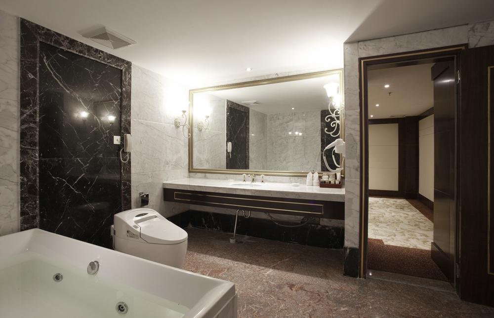 darkly designed bathroom with dark floor vanity and white fixtures - Luxury Bathroom
