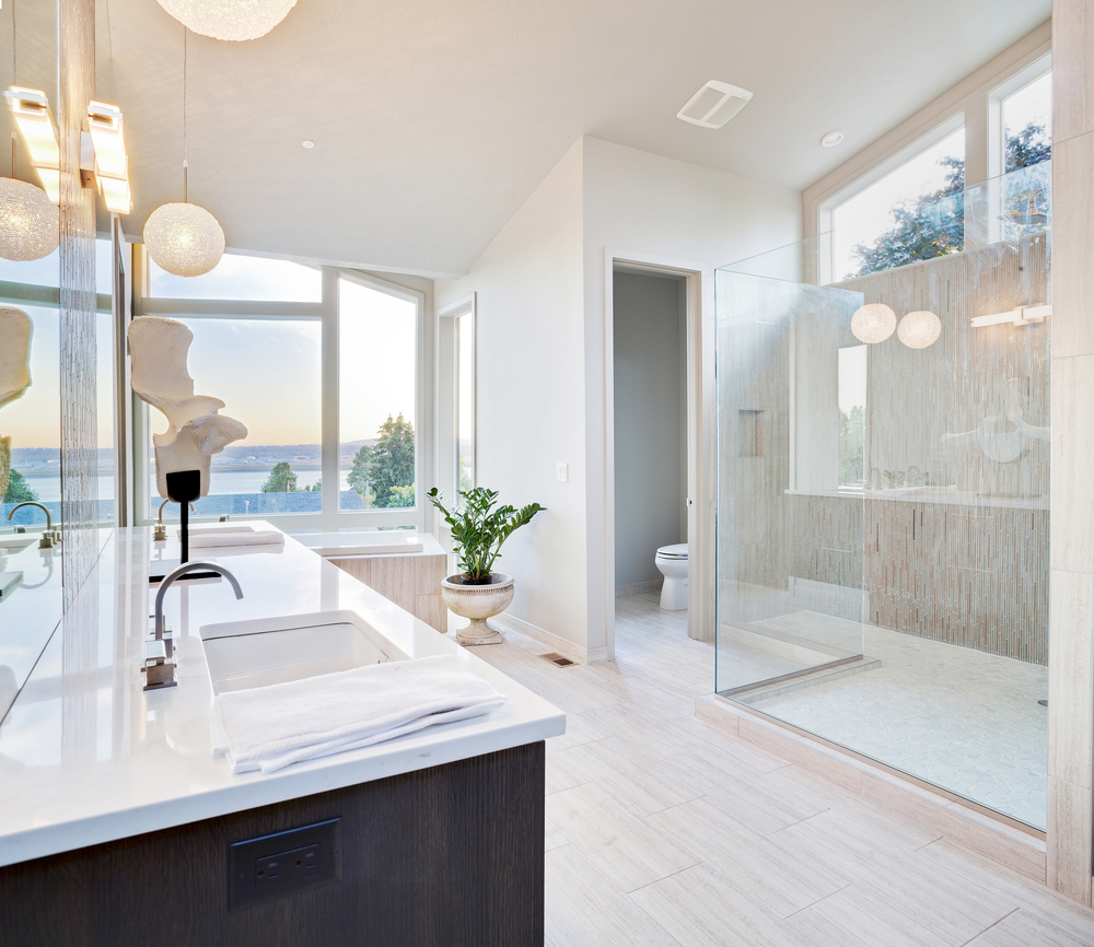 Bright and airy bathroom withe extensive windows white design offset with  dark vanity  127 Luxury. Light And Bright Bathrooms