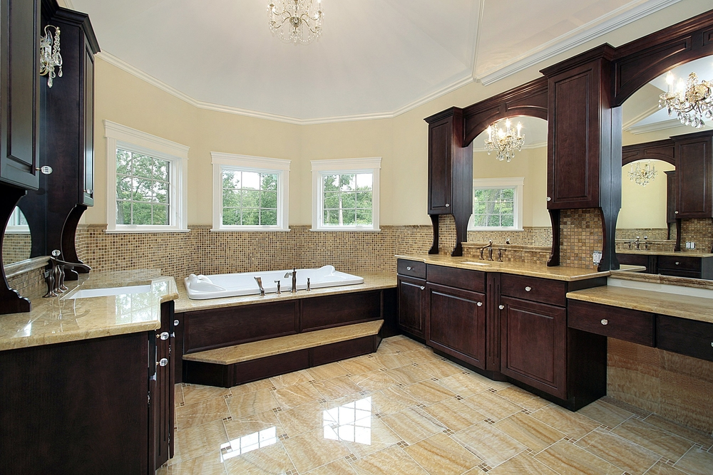 Large Custom Bathroom With Bay Windows And Extensive Custom Dark Wood