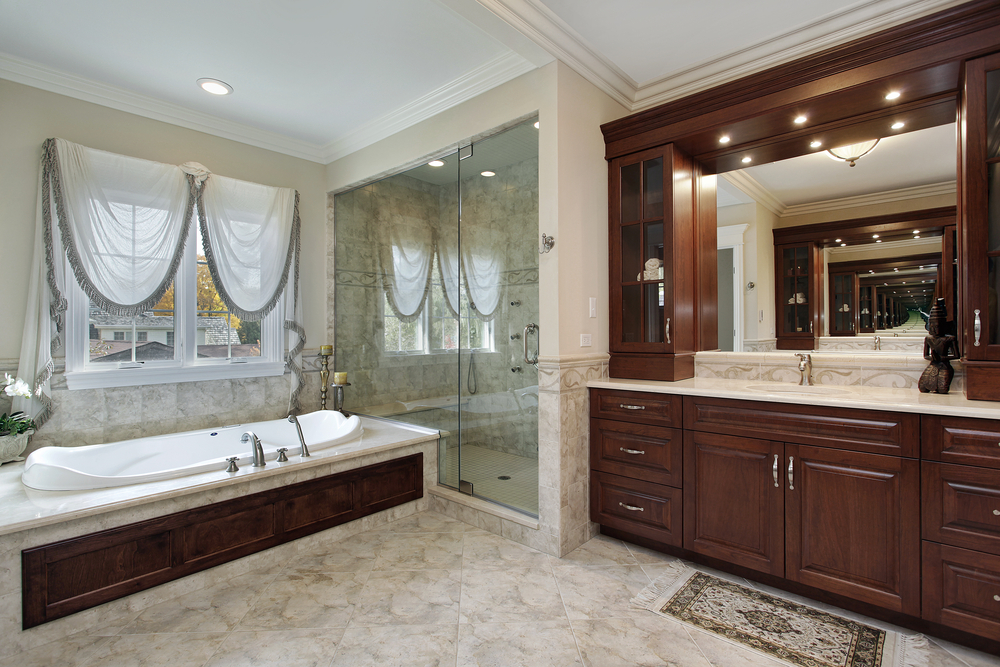 bathroom with floor to ceiling custom wood work for cupboards and sink