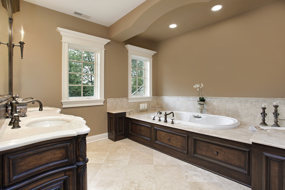 Beige Color Scheme Bathroom With Dark Wood Vanity And Custom Encased Tub Area