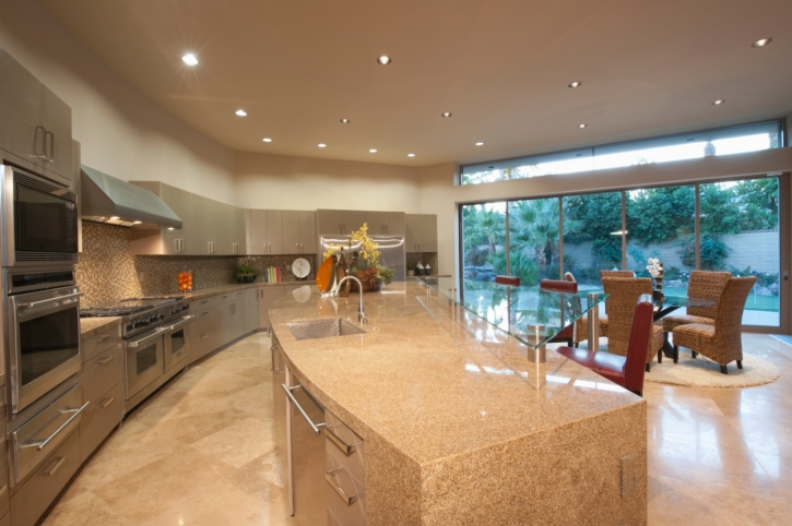 Curved kitchen design with main kitchen area all along one long curved wall with granite curved kitchen island