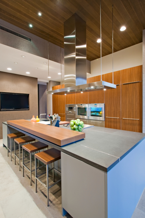 Modern kitchen design in grey, white and natural wood color scheme capped with dark ceiling