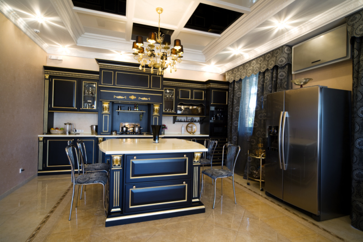 Glitzy kitchen design with ornate dark cabinetry capped in white with black and white checkered ceiling