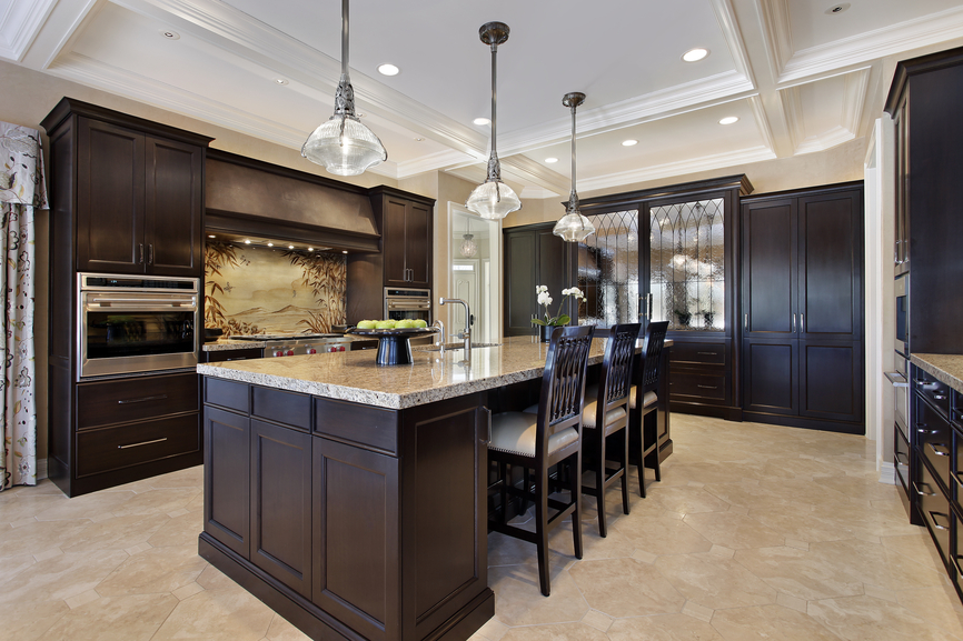 Dark wood kitchen with eat-in island capped with white ceiling