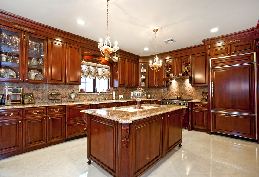Rich wood kitchen design with wood-paneled refrigerator and custom glass  cabinets