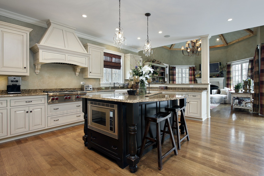 large white kitchen with dark island white ceiling wood floors opening up into the - Large Kitchen Layouts