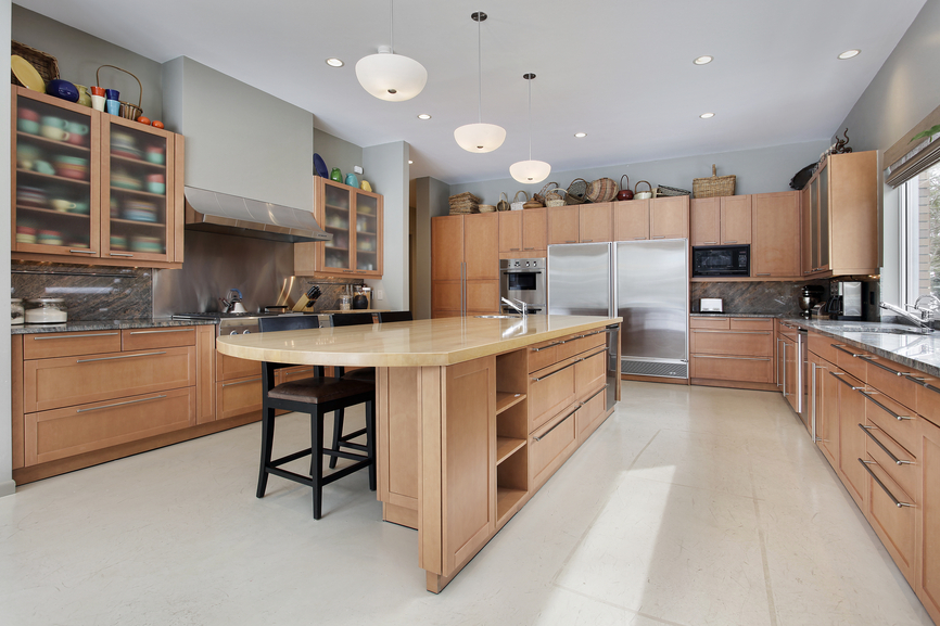 Modern natural wood kitchen with white floor and white ceiling. Stainless steel appliances