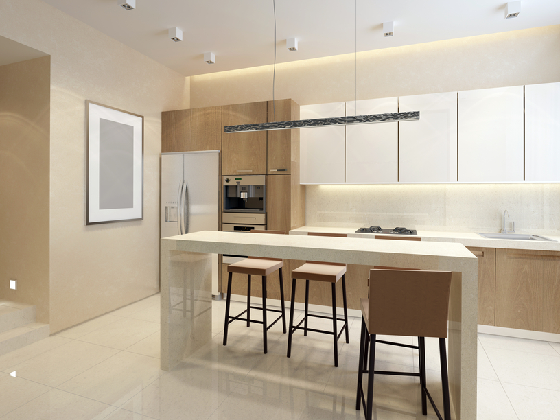 Modern small bright kitchen with light wood cabinets and eat-in table bar/island