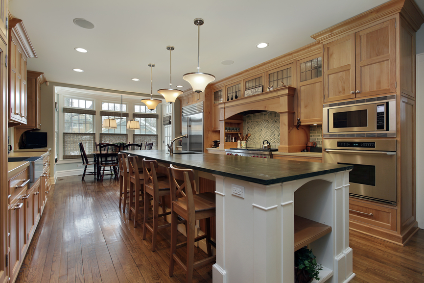 Custom Wood Kitchen With Wood Floor Cabinets Span Both Sides Of The