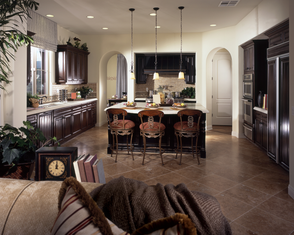 Large Kitchen With White Walls Arched Doors Dark Cabinetry White