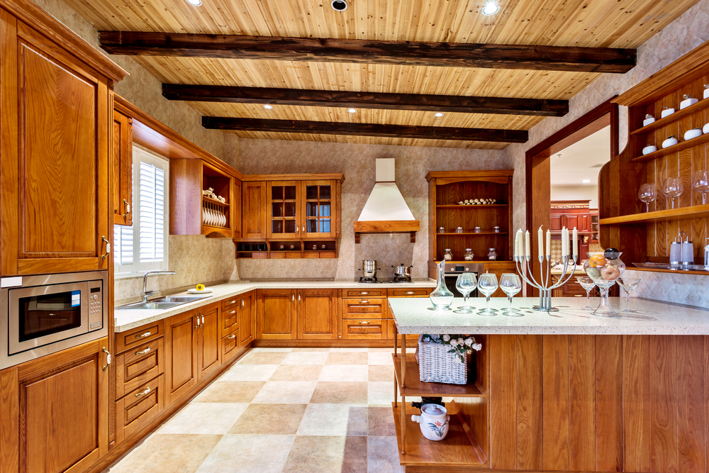 Large Kitchen With Peninsula Designed With Wood Cabinets Floor Is