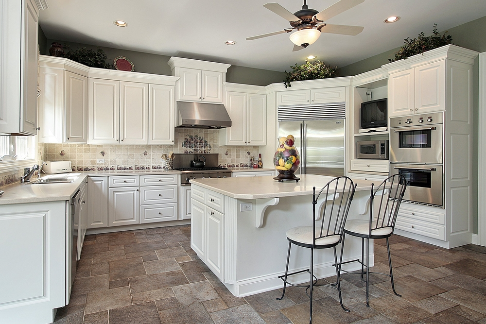 u shaped white kitchen with white counter tops on darker neutral toned tiles with stainless - All White Kitchen Designs