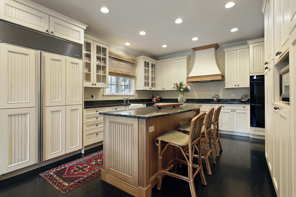Custom Kitchen With White Cabinets Blue Walls And Ceiling Dark Floor And Wood Island