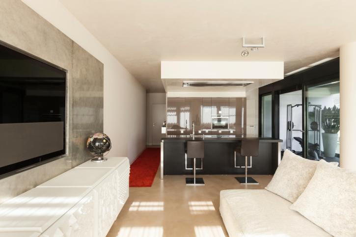 White modern man cave with large flat screen TV and mini bar