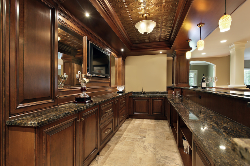 Large dark wood bar in basement of luxury home