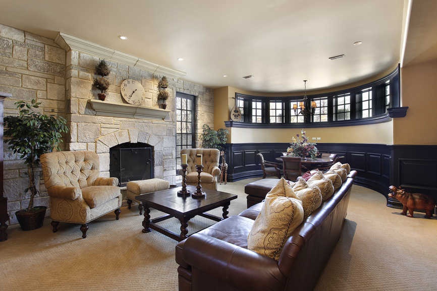 luxury man cave sitting area with fireplace