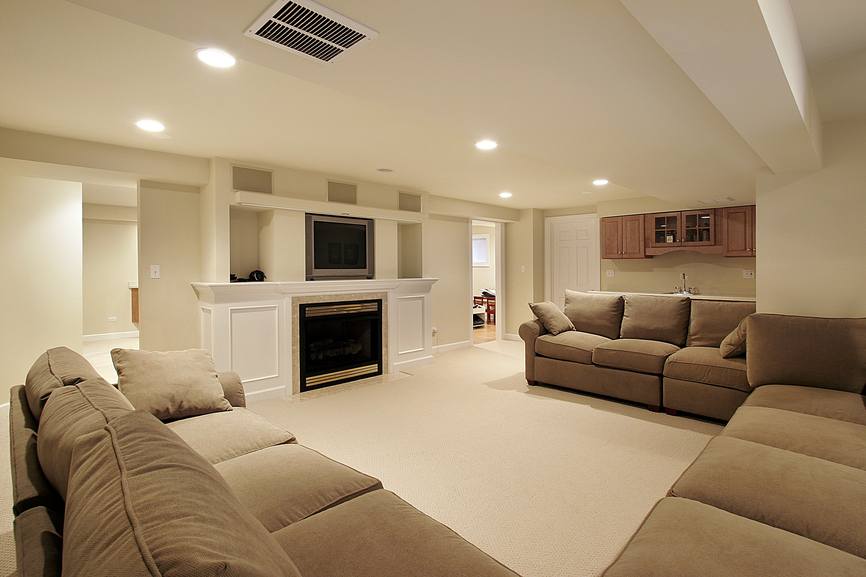 Picture of contemporary man cave design with sectional sofa, fireplace and TV