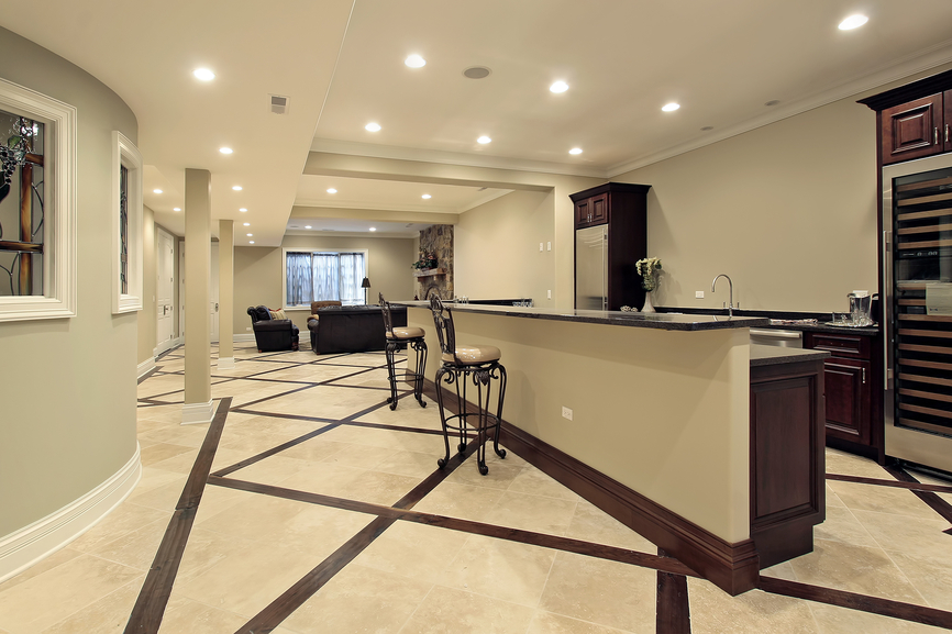 Elegant finished basement with mini-kitchen and TV area