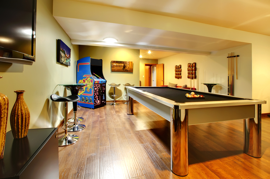 Game-centric man cave design idea with billiards table and arcade